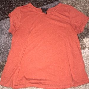 orange slightly cropped t-shirt